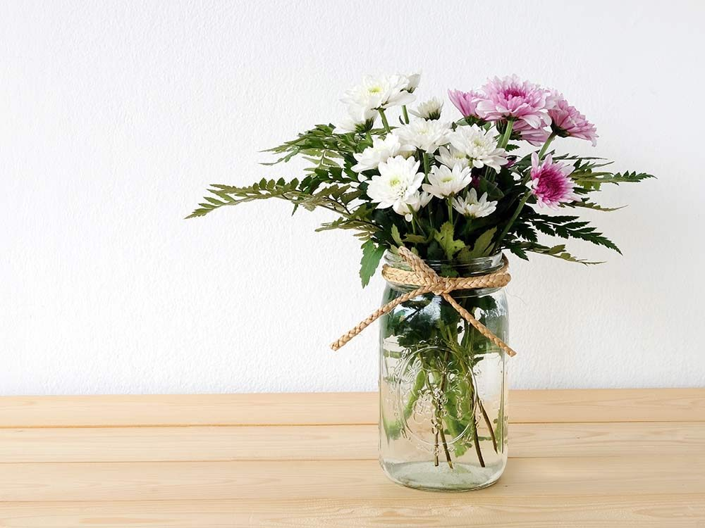Flower centrepiece in mason jar