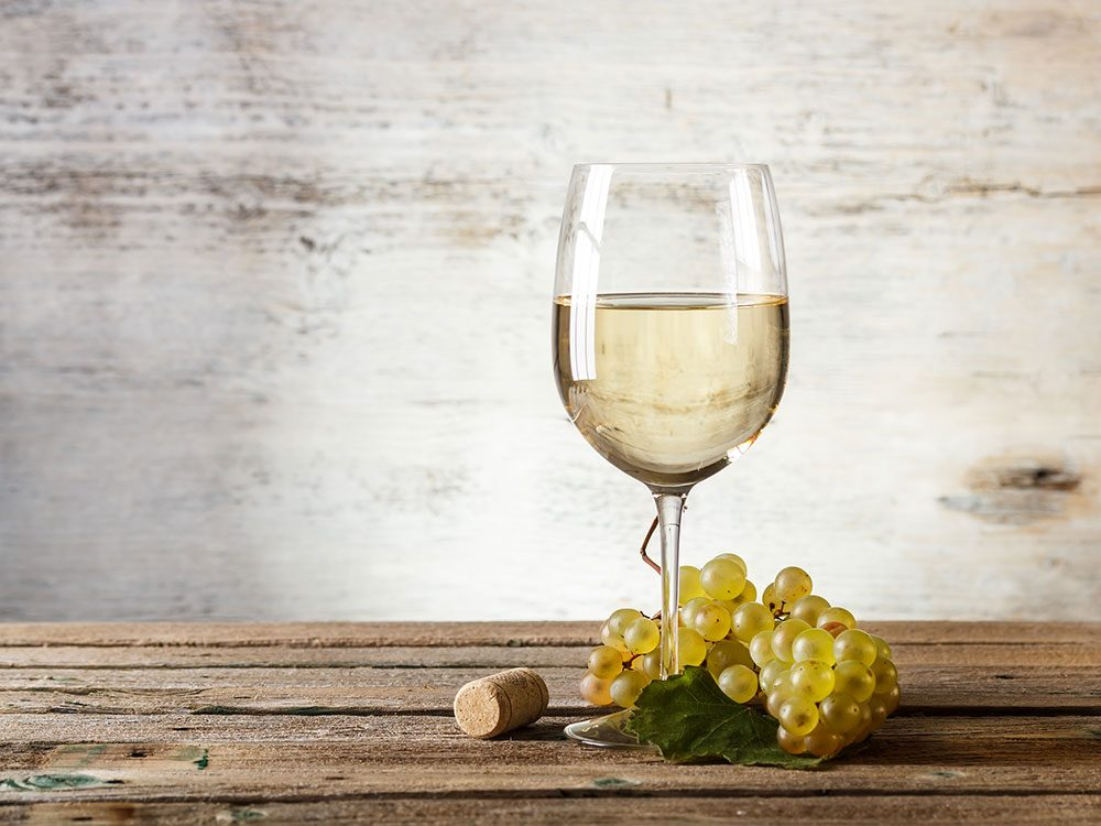 White wine on rustic table