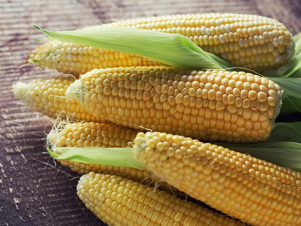 Corn on the cob on wooden table
