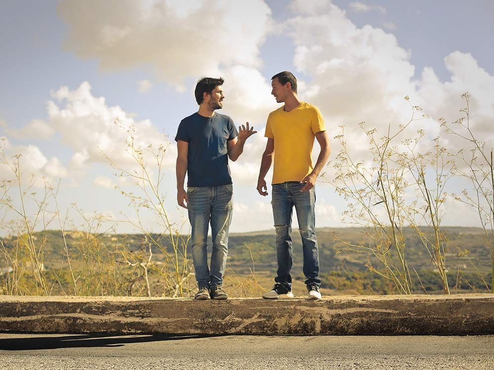 Two friends telling jokes
