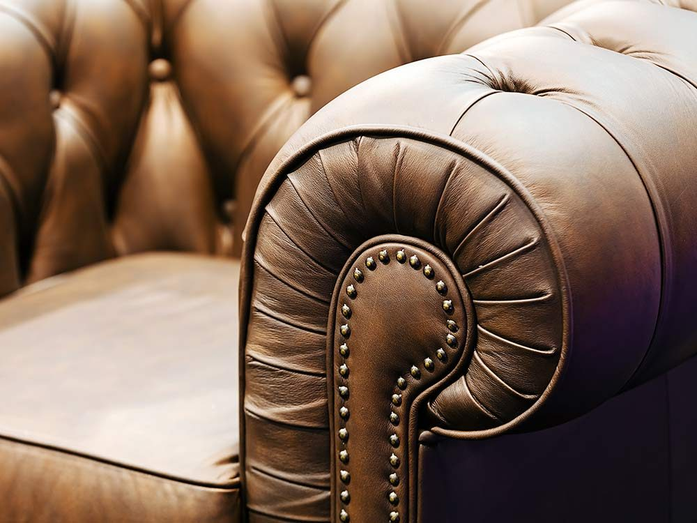 Brown old-fashioned leather sofa