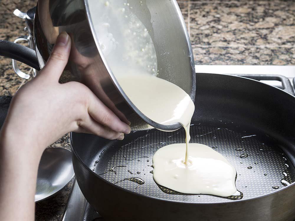 Pancake batter being poured into pan