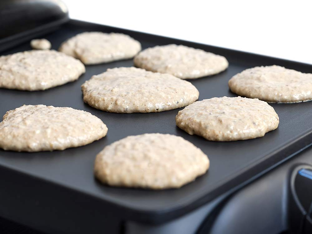 Oat pancakes cooking on barbecue