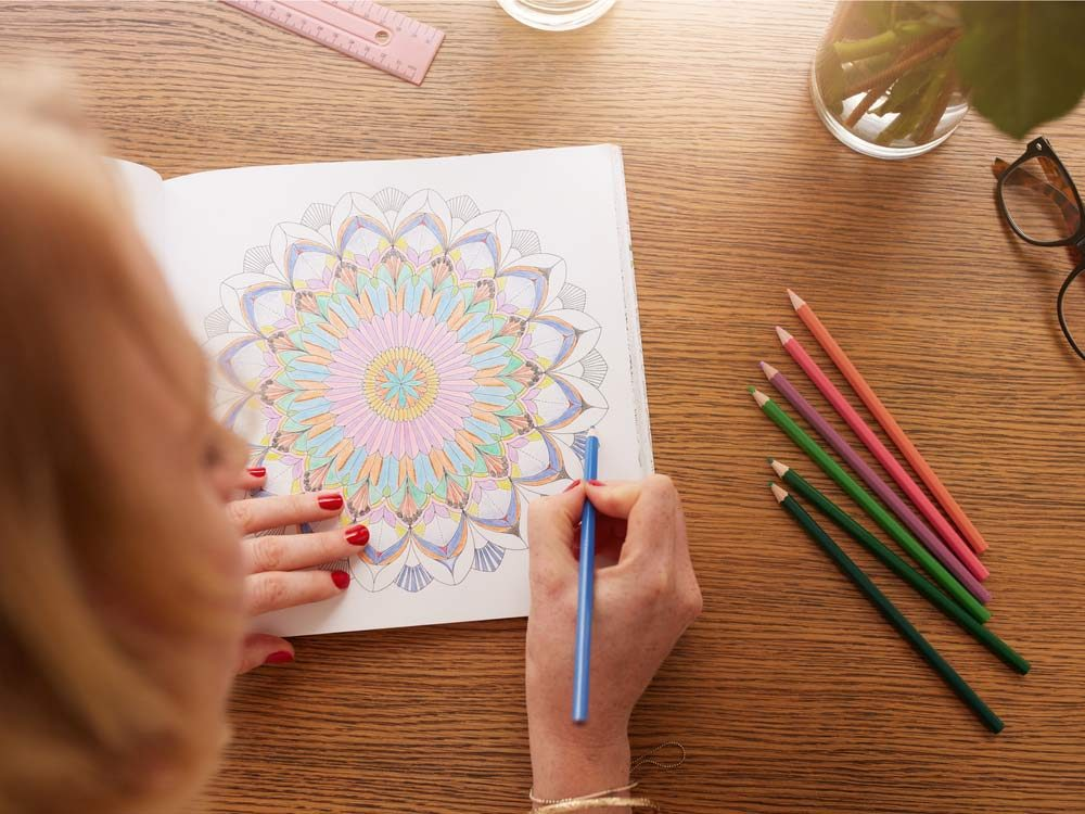 Senior woman colouring in book