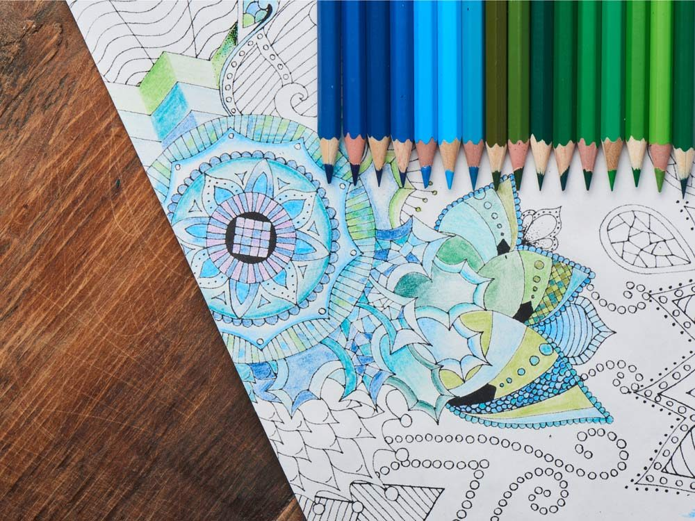 Adult colouring book with pencil crayons