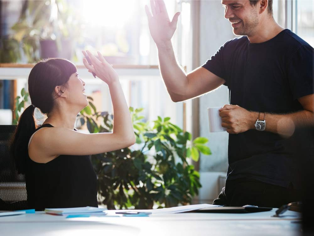 Use these body language tricks to bond at work