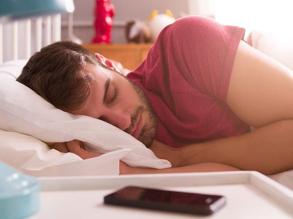 Bearded man sleeping in the morning
