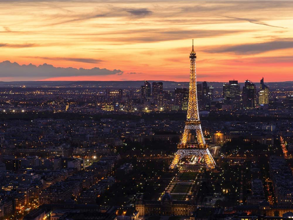 Eiffel Tower against sunset backdrop