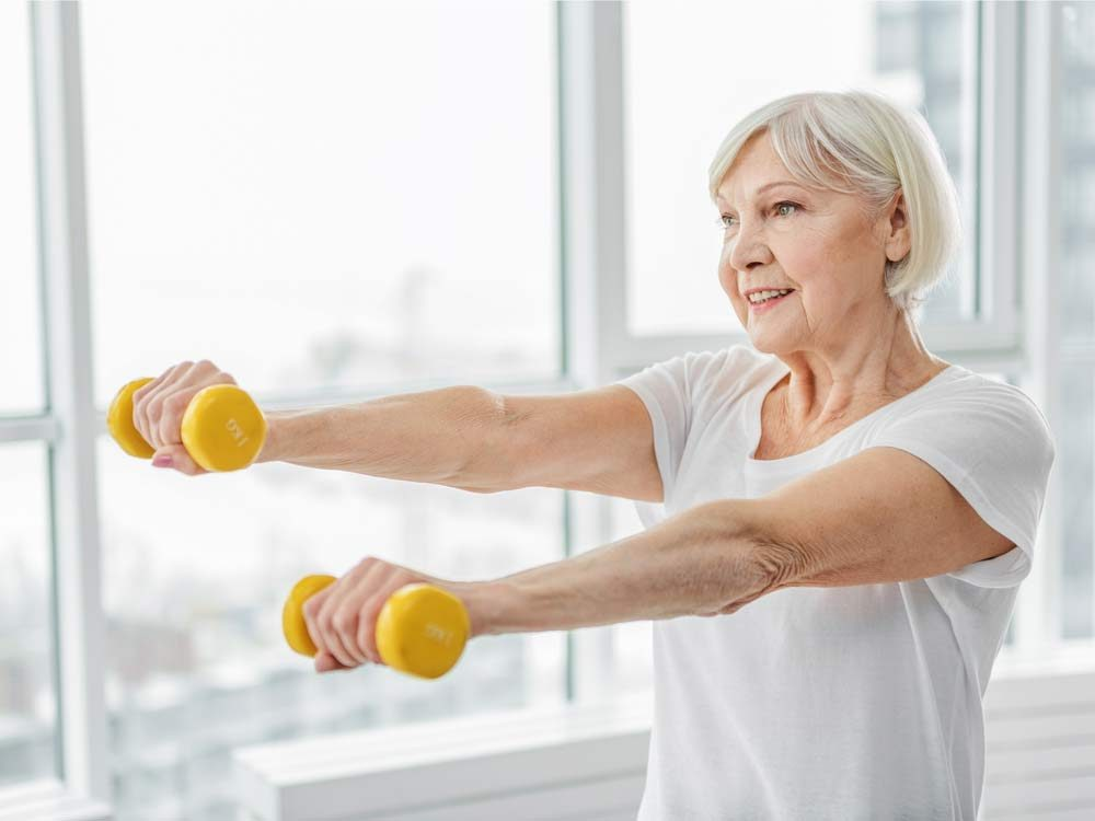 Elderly woman exercising with weights