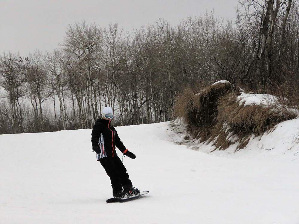 Snowboarding outdoors in winter