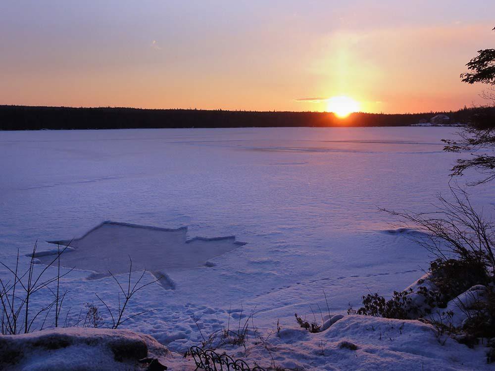 Sunset on snowy field