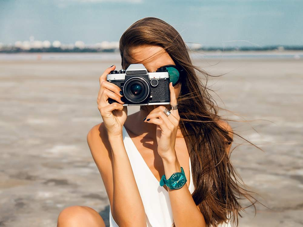 Hipster woman using vintage camera