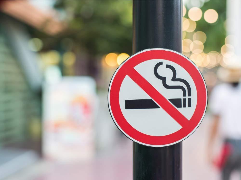 """""""No smoking sign"""" on street"""