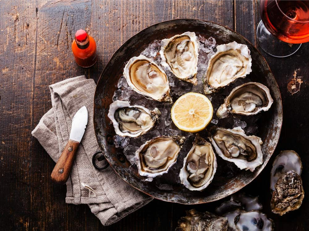 Opened oysters on plate