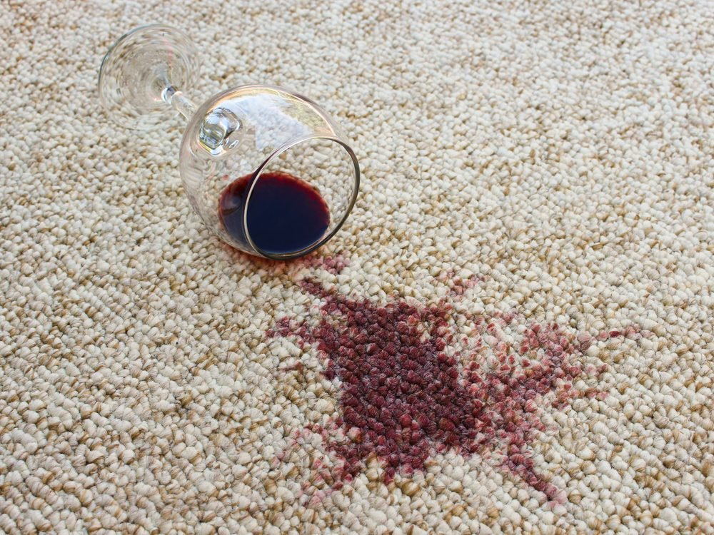 Red wine spilled on white carpet