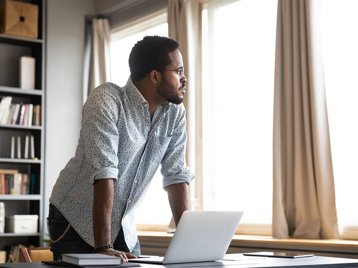 Signs Of ADHD In Adults - distracted man looking out window