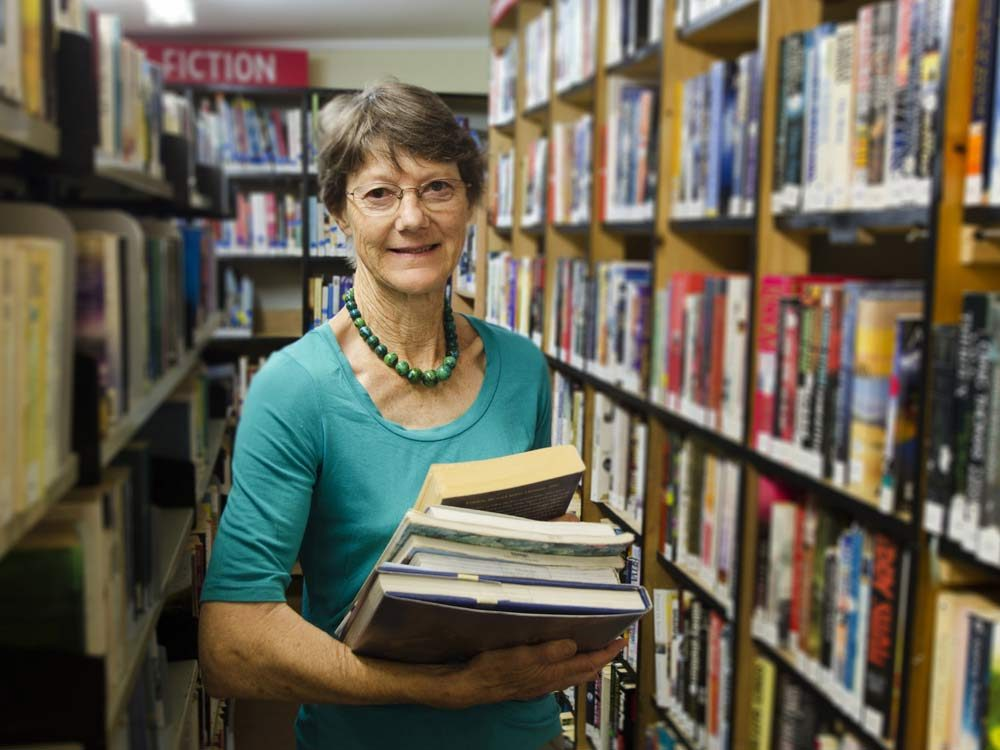 Female librarian at public library