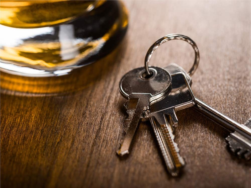Car keys next to glass of beer