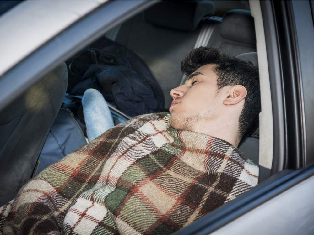 Man sleeping in his car