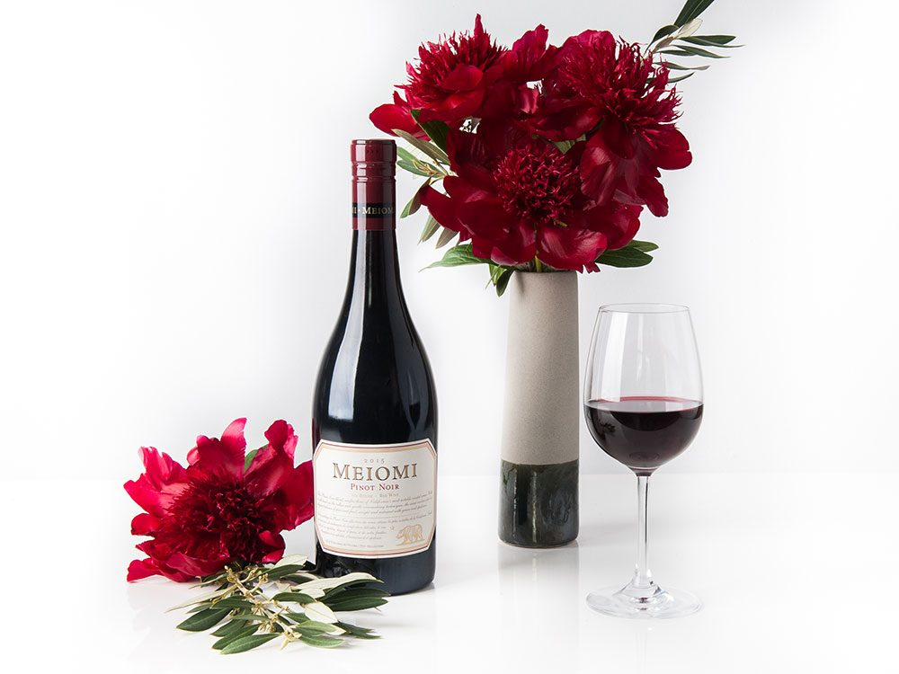 Meiomi pinot noir paired with flower arrangement