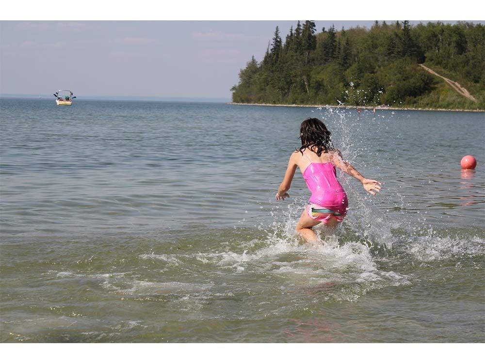 Little girl playing in lake