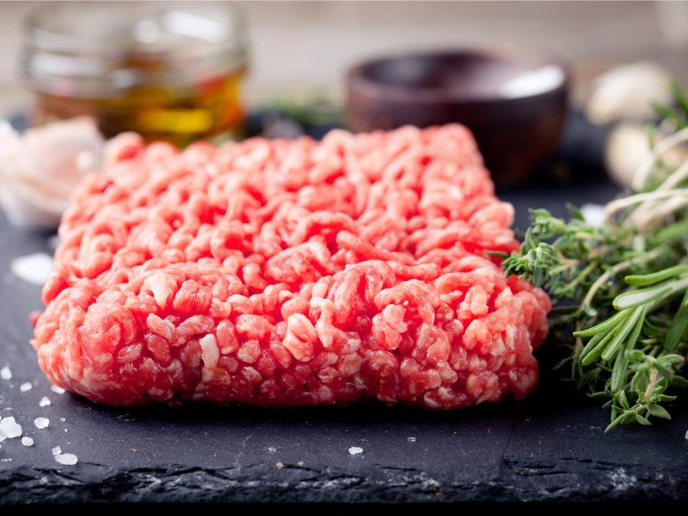 Ground meat on chopping board