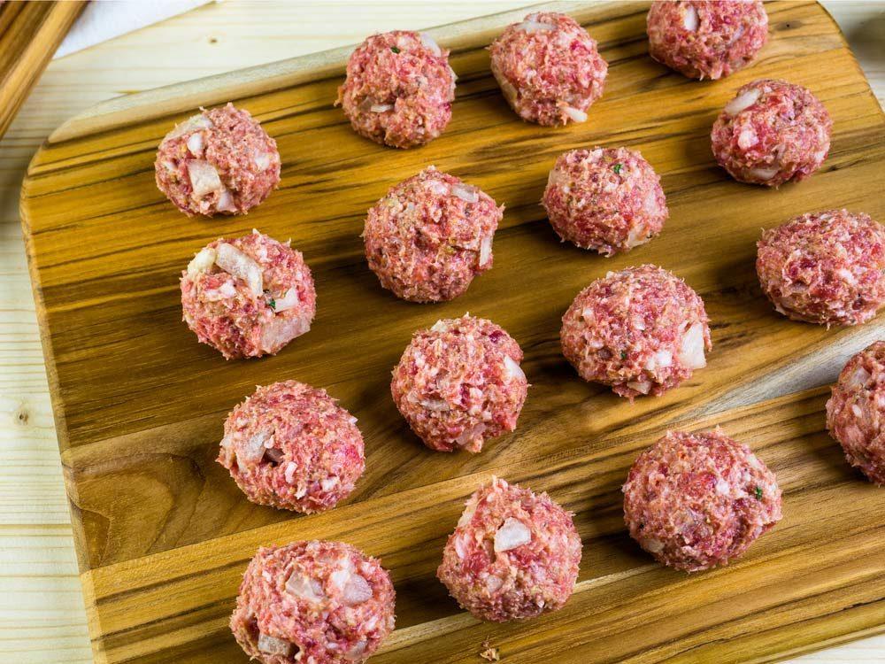 Meatballs on wooden board