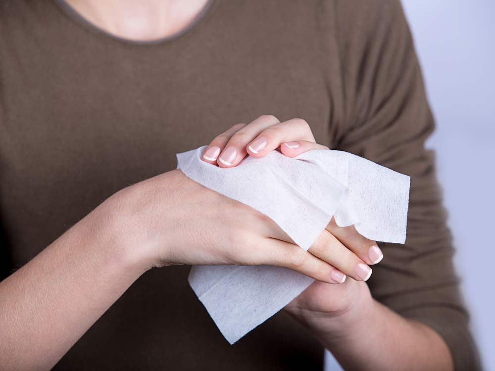 Woman using hand wipes