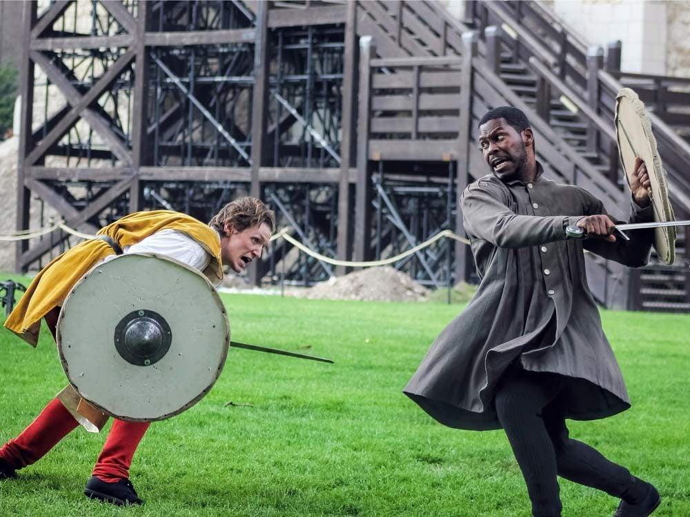 Two Shakespearean actors fighting
