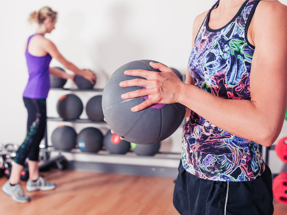 A pullover throw is an a core stability exercise that flattens your abs without crunches