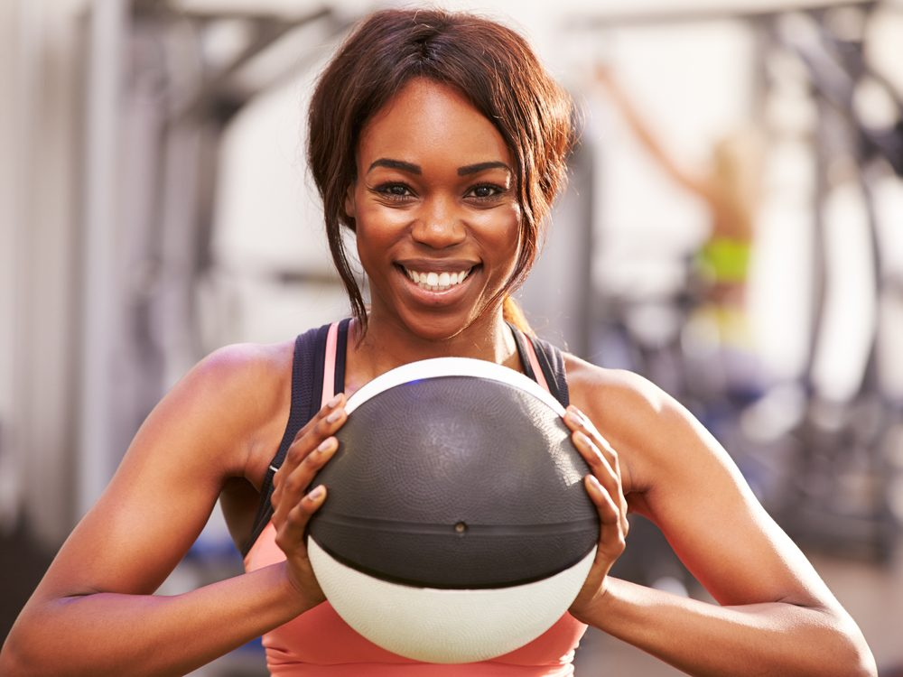 A soccer throw is a core stability exercise that flattens your abs without crunches