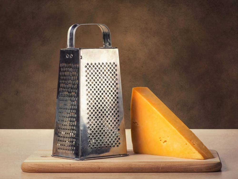 Cheese grater with cheddar