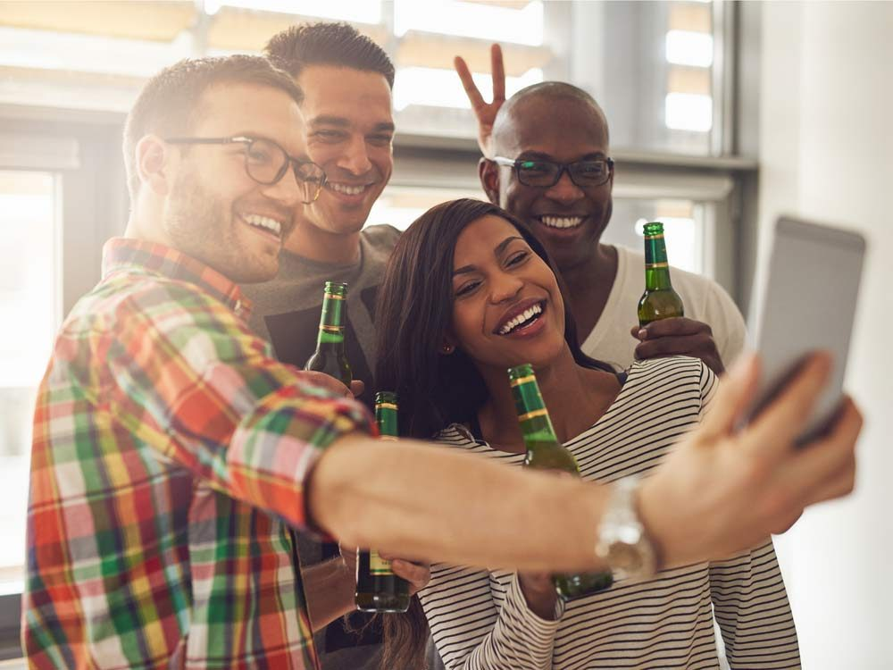 Coworkers taking a selfie at office party