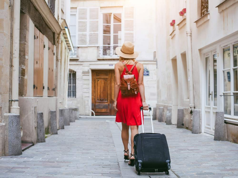 Woman with luggage in foreign country