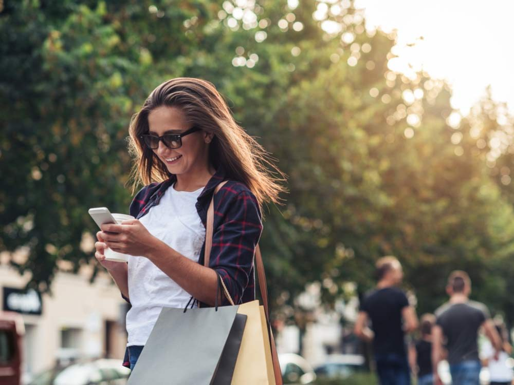 Woman shopping while on phone