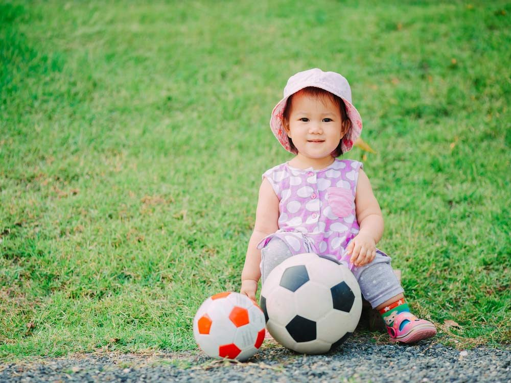 Asian child with soccer balls