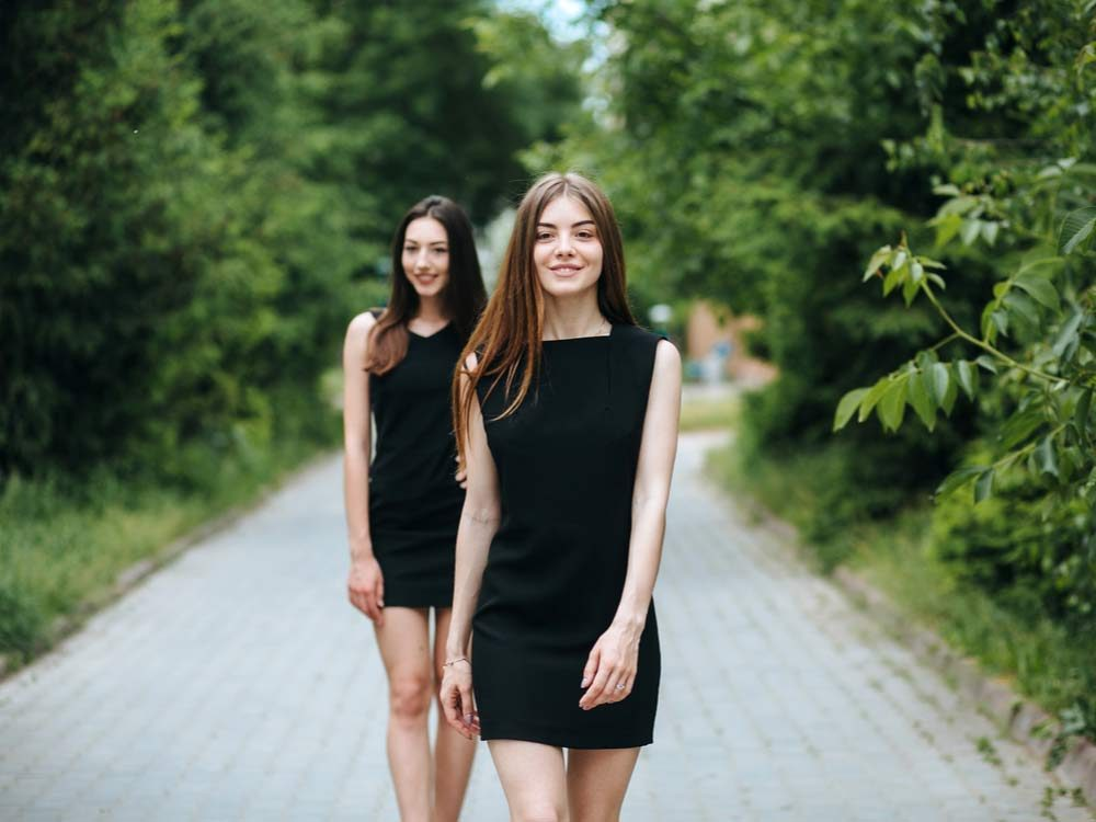 Two women in little black dresses