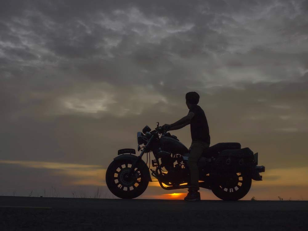 Silhouette of motorcyclist