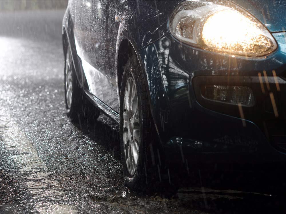 Car driving in rainstorm