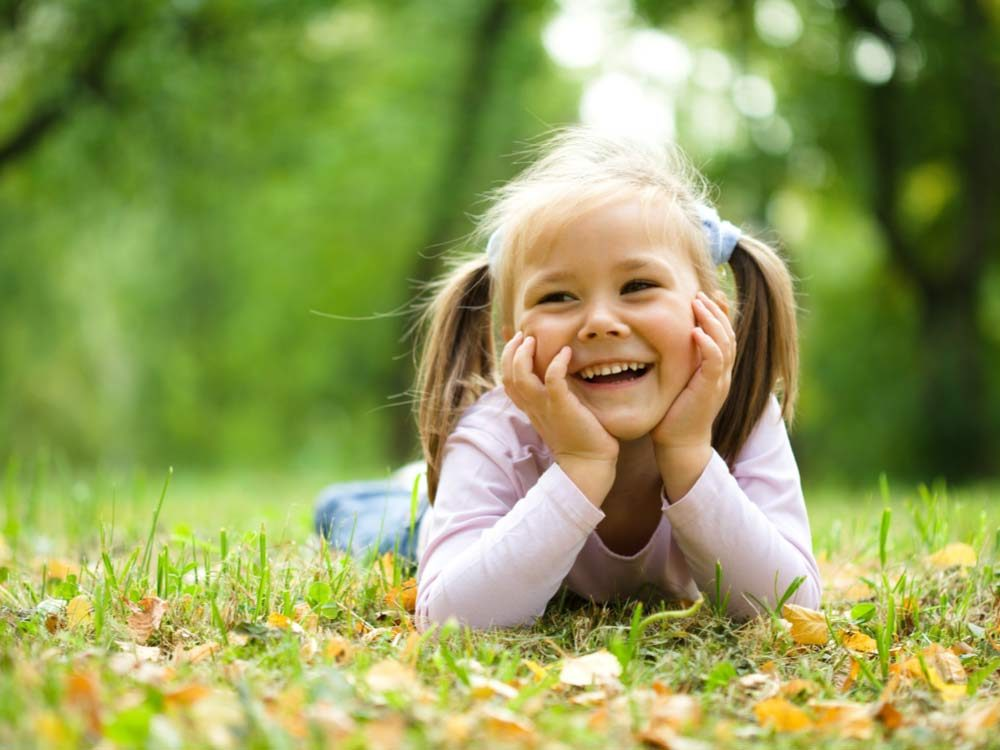 Little girl smiling in park