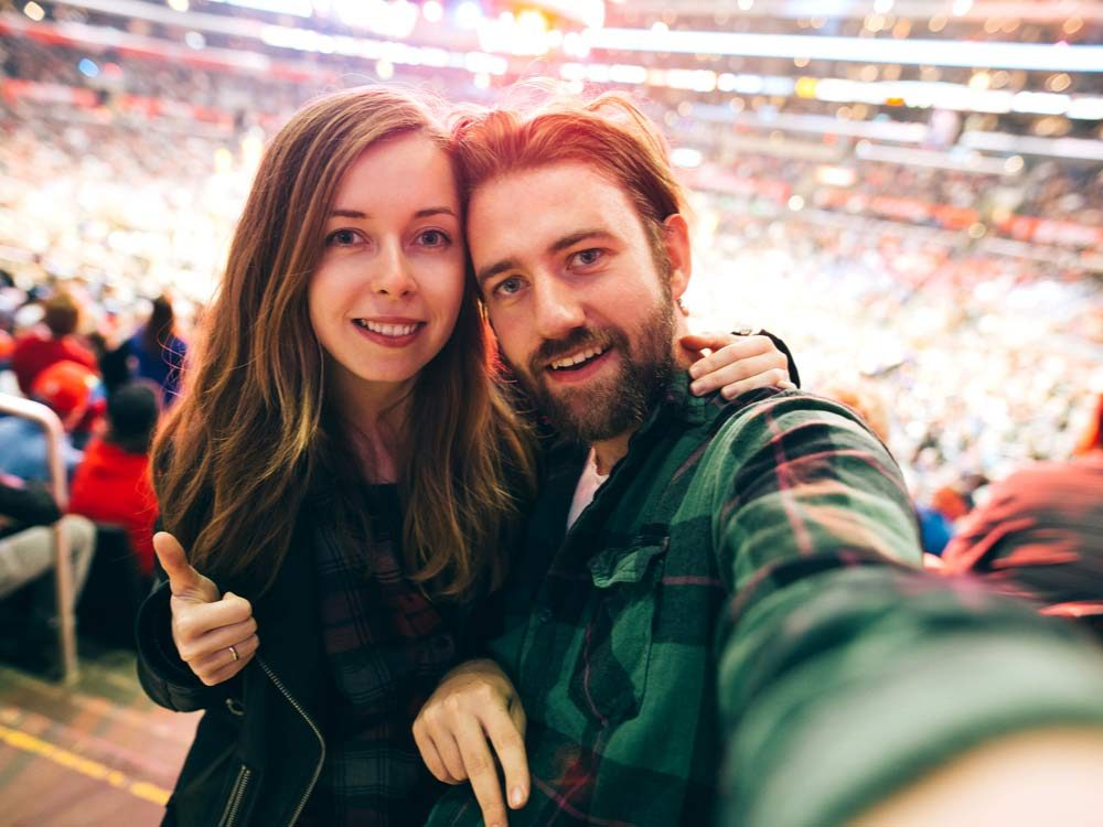 Couple at sports game