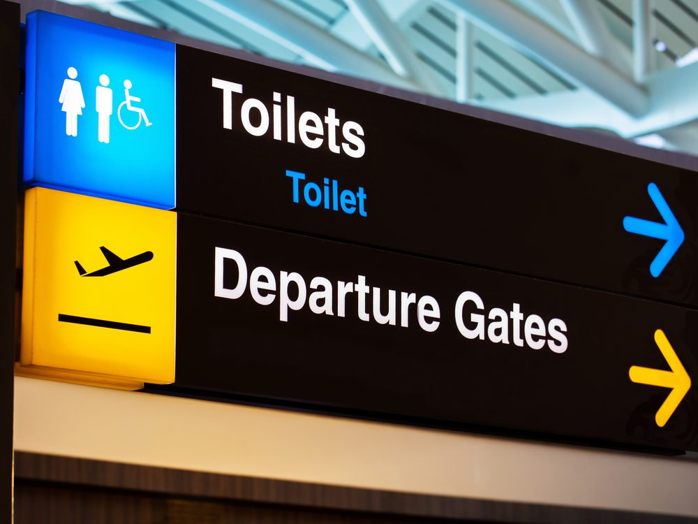 Use the bathroom at the airport terminal