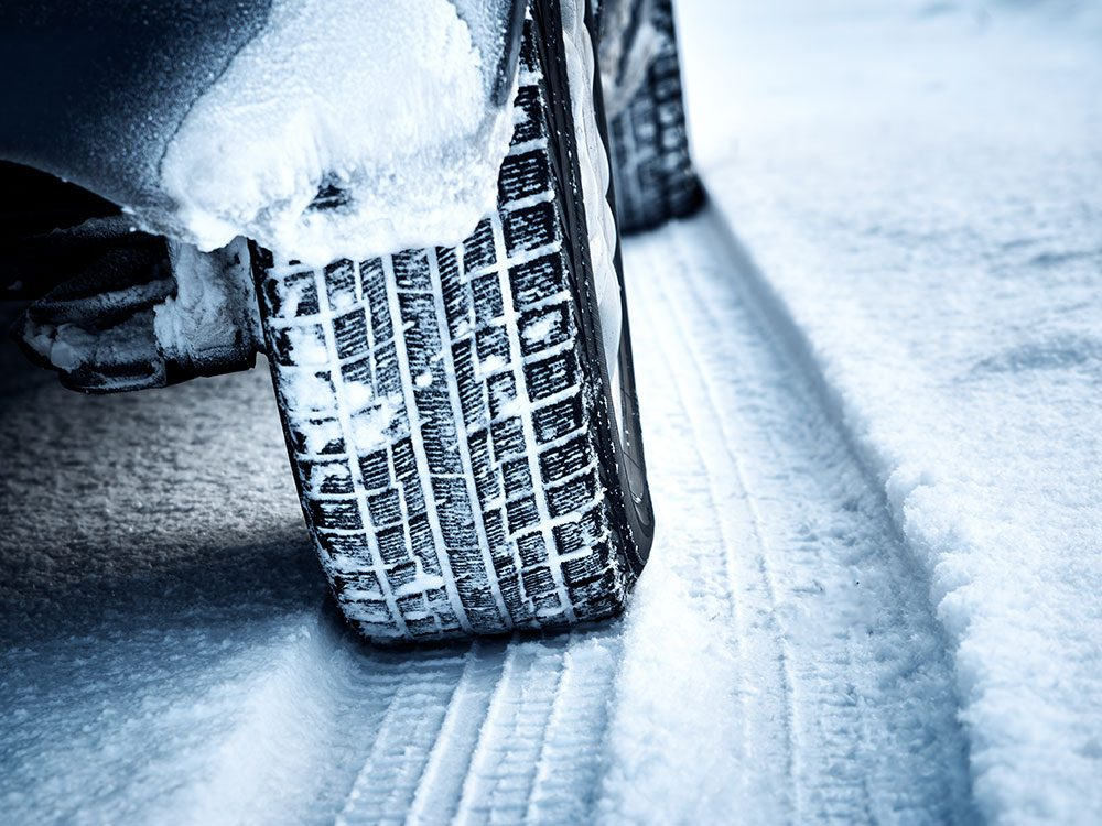 Car tire driving in snow