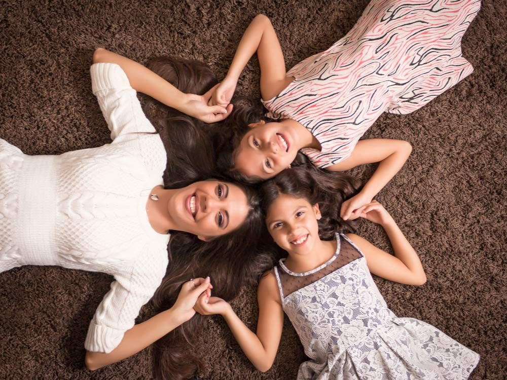 Mother and twin daughters