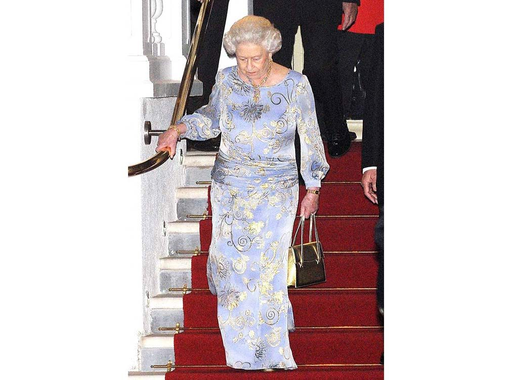 Queen Elizabeth II walking down the stairs