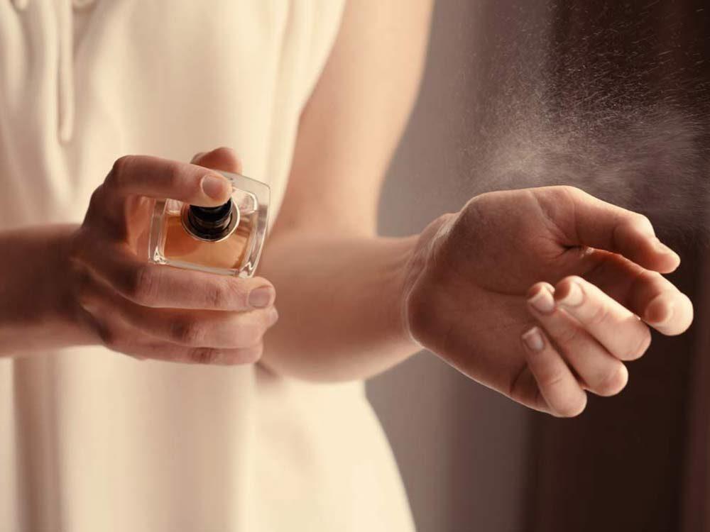 Spraying perfume bottle