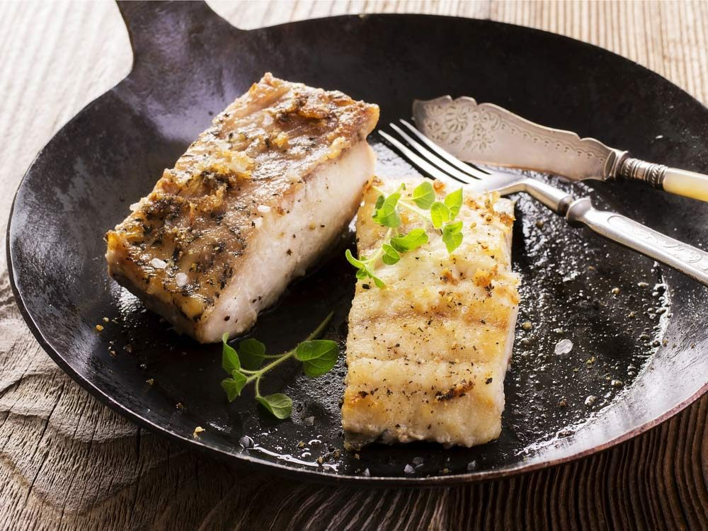 White fish being pan-fried