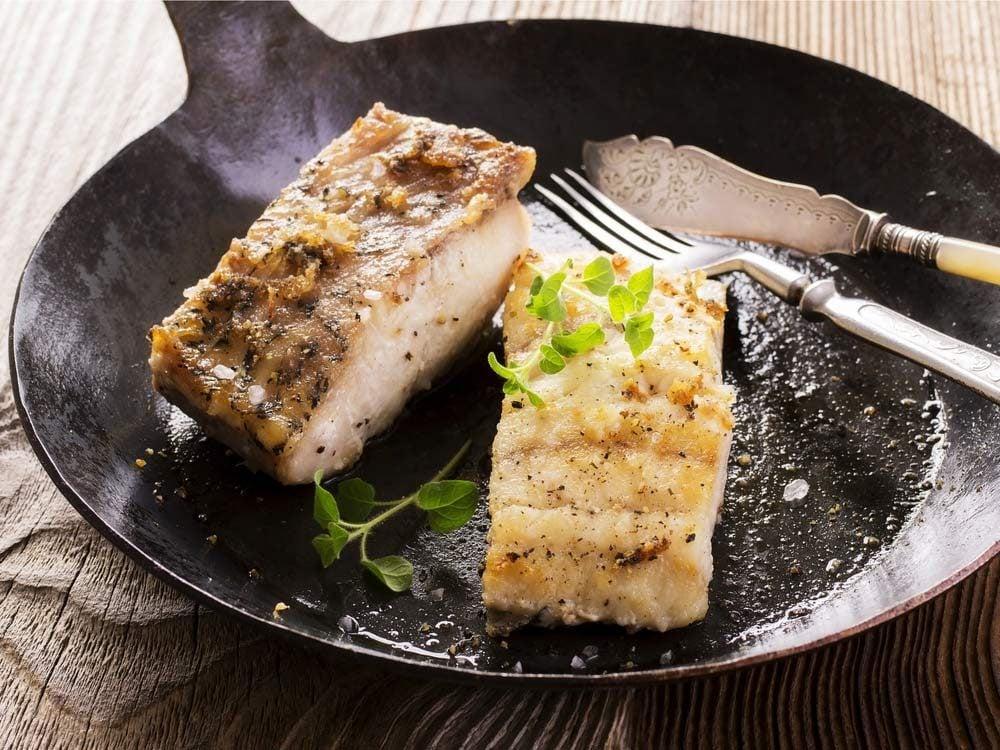 White fish being pan-fried