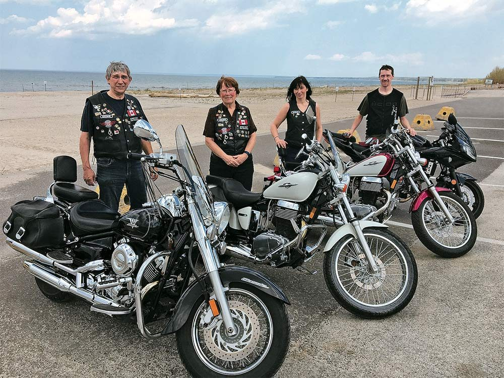Anderson family with their motorcycle