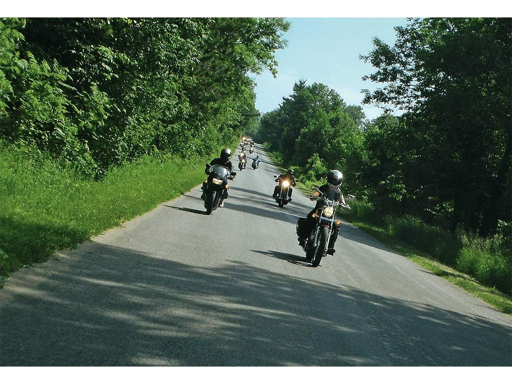 Shelly family riding motorcycle together